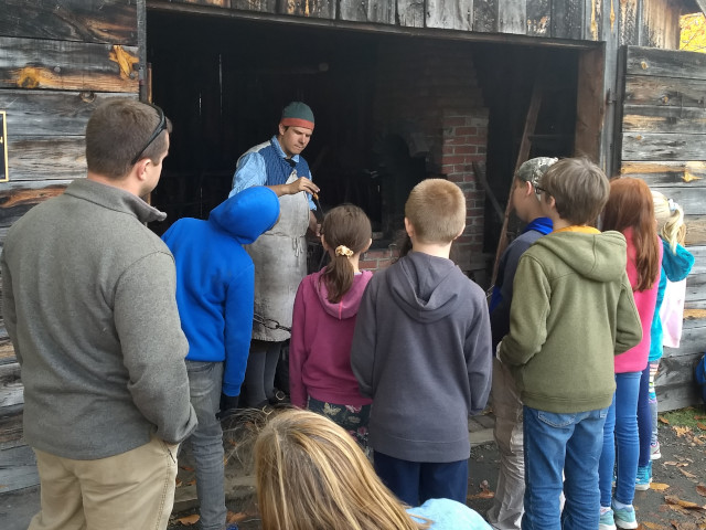 blacksmith speaking with students
